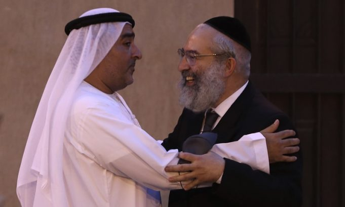 Ahmed Al Mansuri (L), founder of the Crossroads of Civilisation private museum, greets a rabbi at an exhibition commemorating the Holocaust. Israel's top diplomat to the United Arab Emirates attended a ceremony in Dubai on the grounds of the Arabian Peninsula's first permanent exhibition to commemorate the Holocaust.